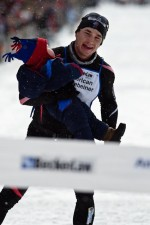 Matt Liebsch carries his son across the finish line of the 2009 American Birkebeiner