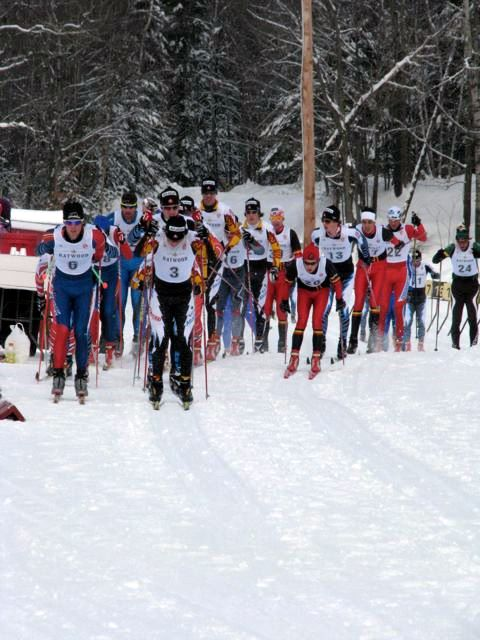 https://fasterskier.com/wp-content/blogs.dir/1/files/2010/01/NorAm-The-mens-field-lapping-through-the-stadium-in-the-classic-leg-Saturdays-pursuit.jpg