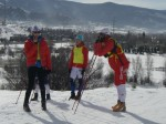 Utah coach Eli Brown chats with women racers and volunteers while waiting for men to lap
