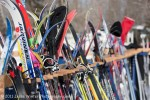 Skis get a rest while their owners warm up with coffee and hotdogs after the race