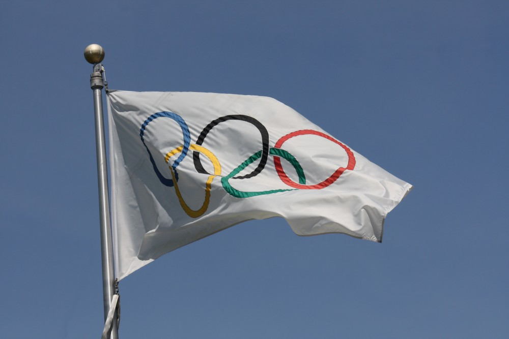 https://fasterskier.com/wp-content/blogs.dir/1/files/2016/07/Olympic_flag-e1469478753946.jpg
