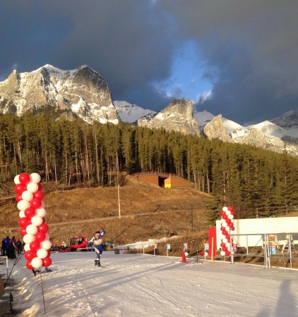 Canmore Nordic's Jonah Steinberg pushes across the finish line. (Photo: Matthias Ahrens)