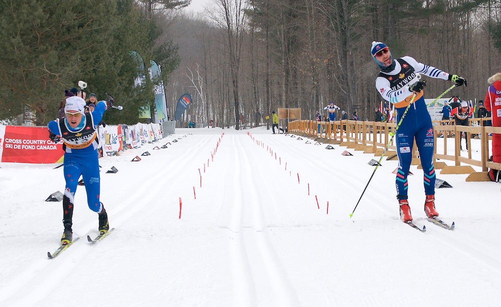 Rémi Drolet (bib 13, left) caught Angus Foster at the line to finish second. (Photo: 2019 Canadian Ski Championships)