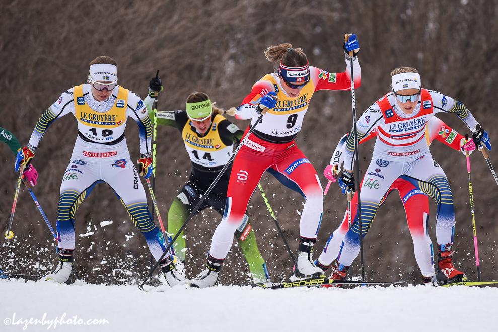 Maiken Caspersen Falla (#9) leads the third quarterfinal. Stina Nilsson (red bib) and Falla moved on to semis. (Photo: John Lazenby)