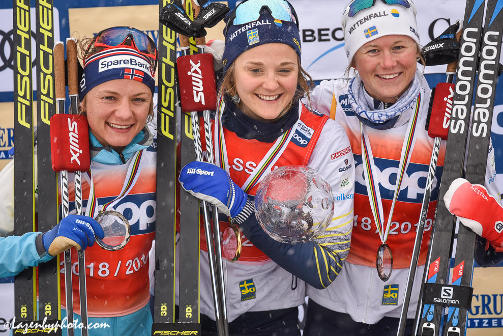 The sprint crystal globe was awarded to Stina Nilsson (centre) at the end of the day. Maiken Caspersen Falla (left) and Maja Dahlqvist were second and third. (Photo: John Lazenby)