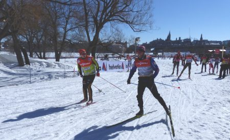 ÉVGNE was the host for stage 1 of the Ski Tour Canada in Gatineau. Martin Johnsrud Sundby inspects the course with Ottawa's parliament building visible in the background. (Photo: Peggy Hung)