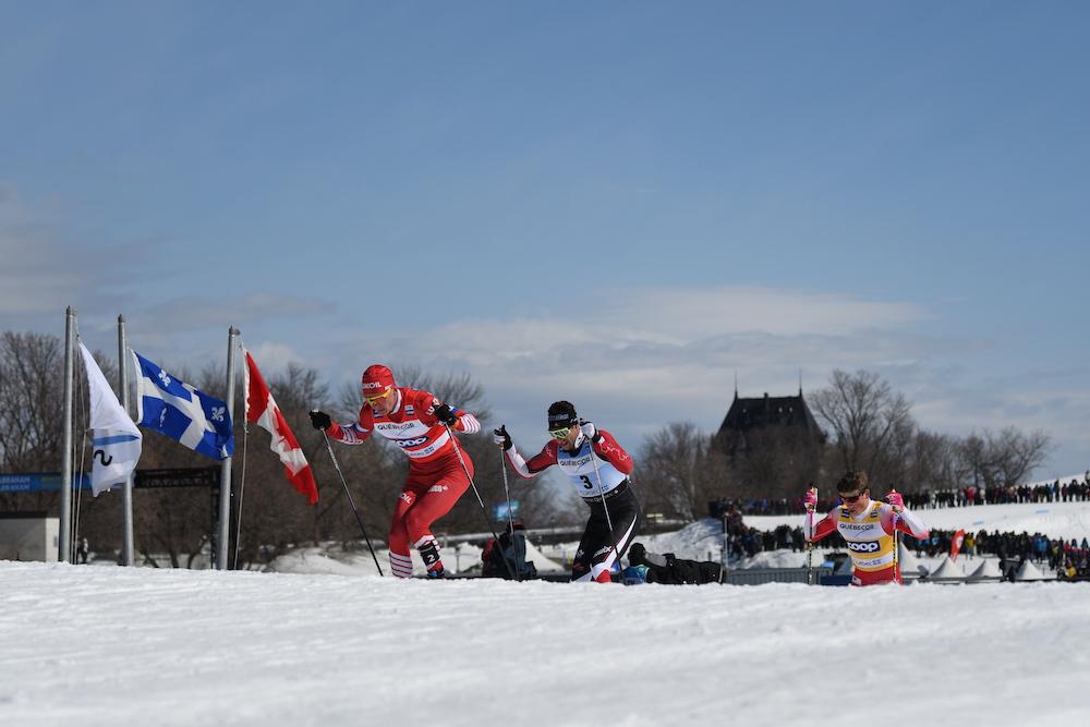 Alexander Bolshunov leads Alex Harvey and Johannes Høsflot Klæbo in the pursuit. (Photo: Doug Stephen)