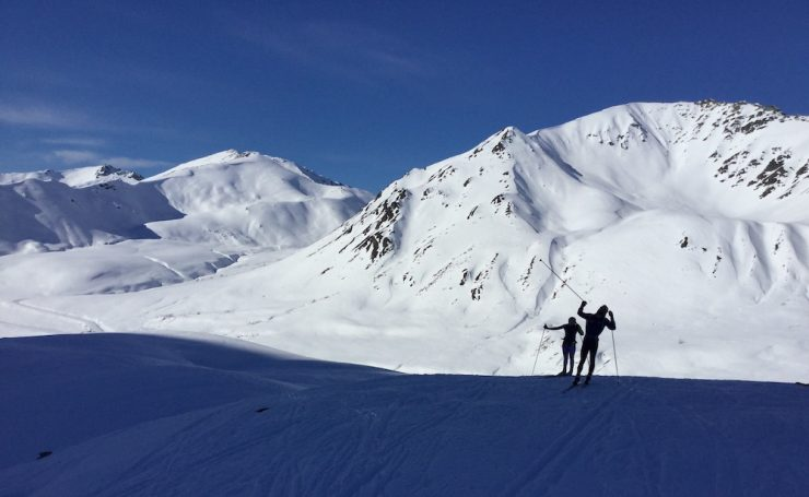 Duncan Wright (r) and Julia Ditto crust skiing in Hatcher Pass, Talkeetna Mountains, Alaska, April 2018. (photo: Gavin Kentch)
