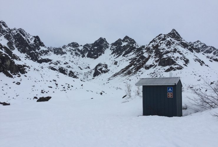 The eponymous outhouse of the Race to the Outhouse #2, Archangel Road, Talkeetna Mountains, Alaska, in April 2018. (photo: Gavin Kentch)