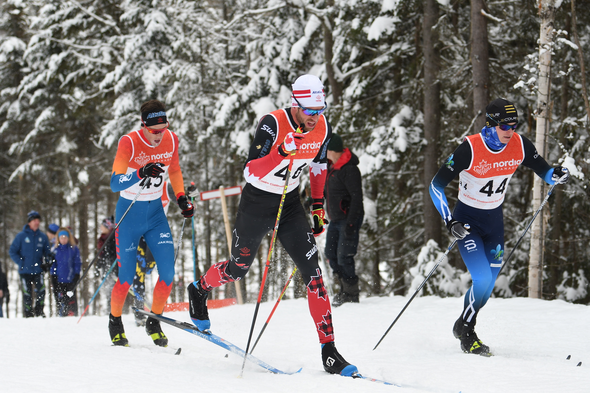 Russell Kennedy (#46) caught Sam Hendry (#45) and Nicolas Beaulieu (#44) on his way to third place in the 15km. (Photo: Doug Stephen)
